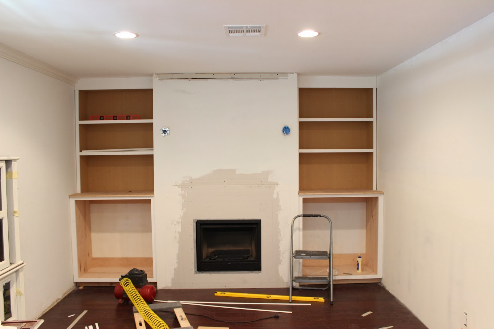 This helped tie the cabinets and fireplace in to the room and make it look  built in. Overall we really love the way that this wall looks like it has  been ...