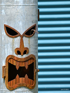 angry tin tiki face