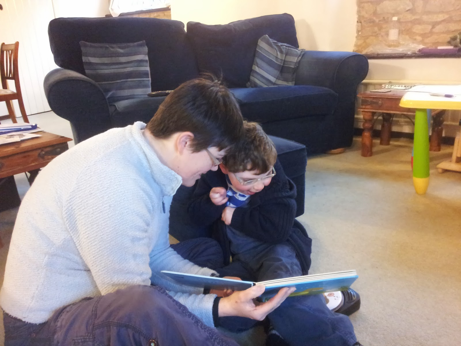 Seth reads with mummy