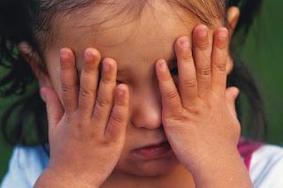 Child playing peek a boo
