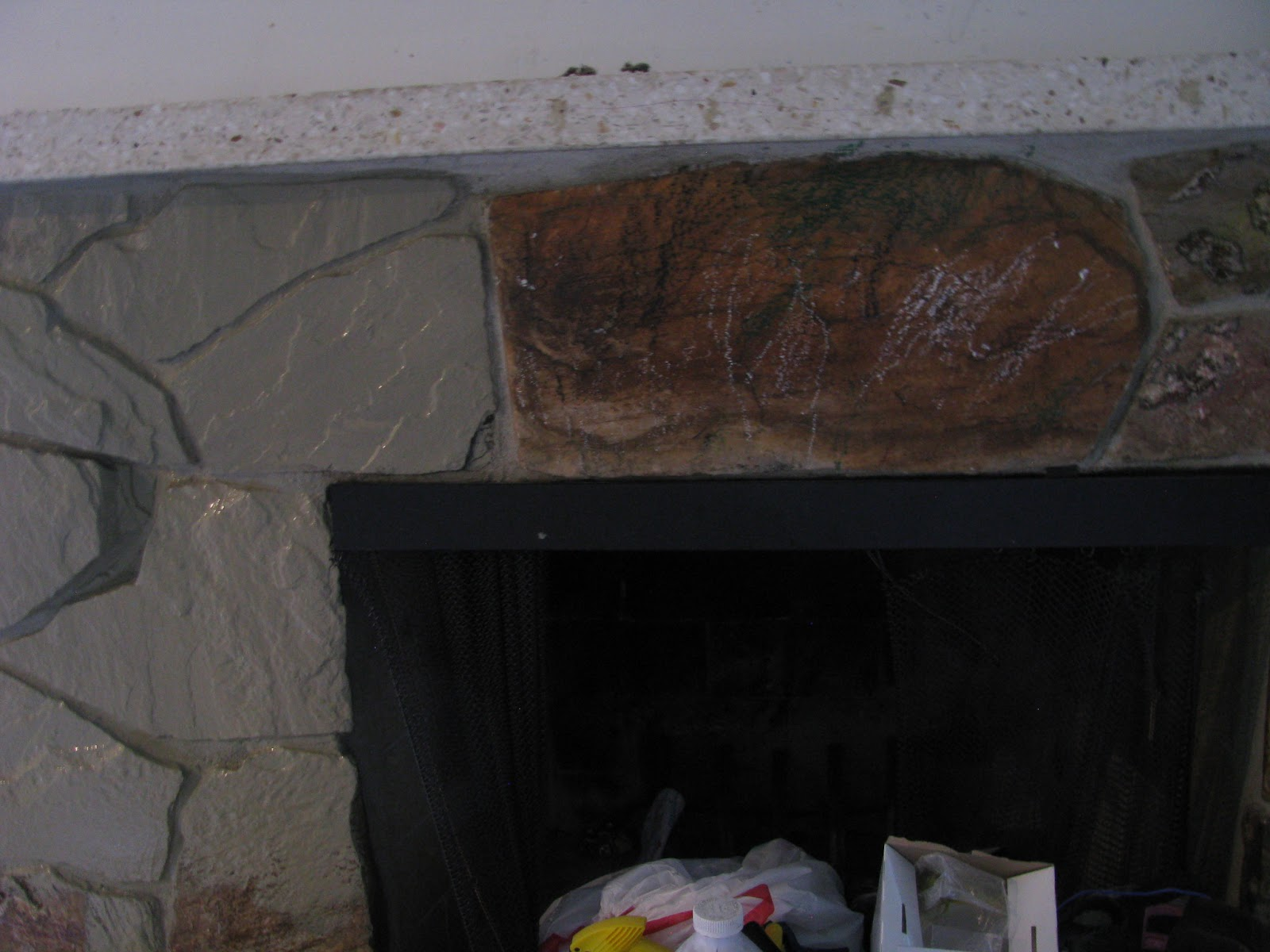JOYS OF HOME: Painting a Rock Fireplace