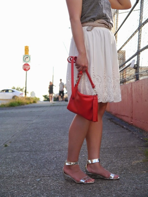 White eyelet skirt, silver sandals, little red bag