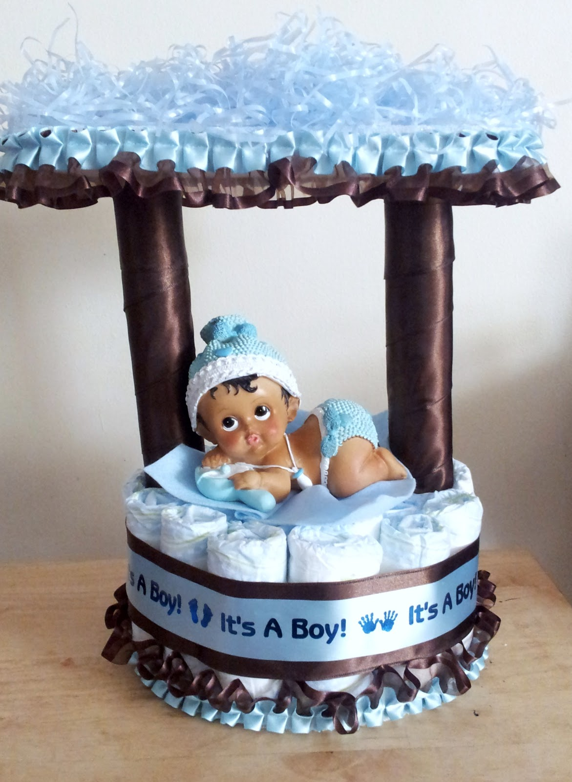 light blue and brown baby boy wishing well pamper cake