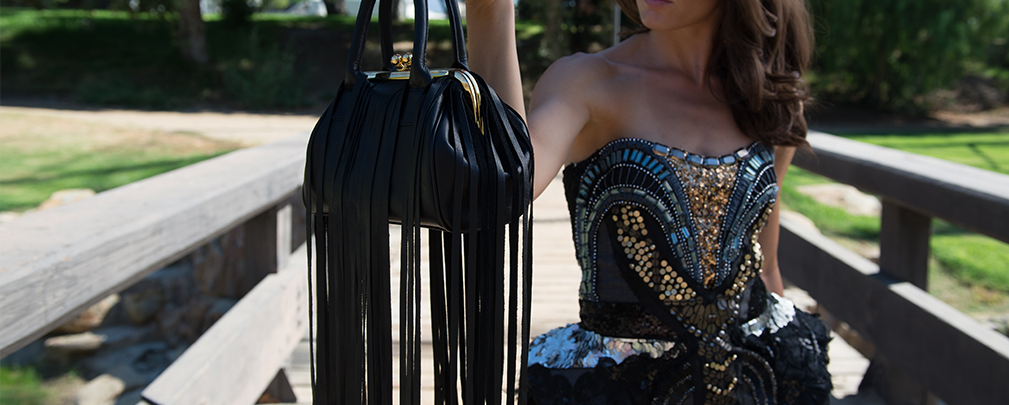 http://skinny-bags.com/?product=on-the-fringe-black-leather-bag