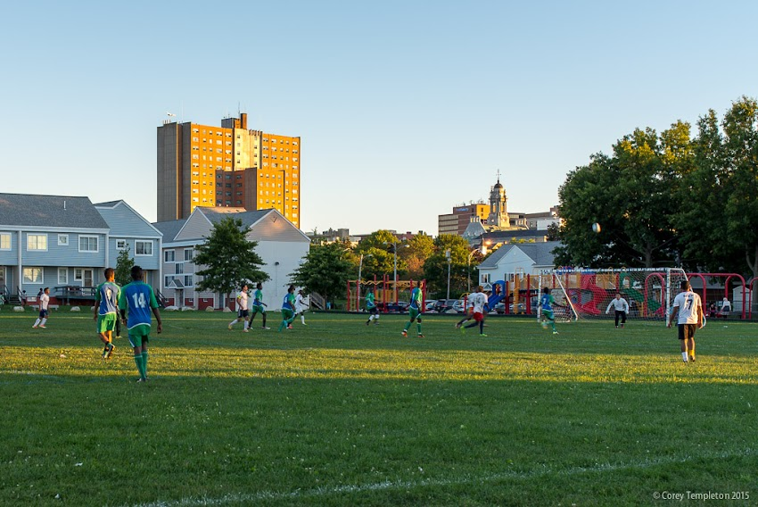 September 2015 Portland, Maine USA photo by Corey Templeton. A late afternoon soccer/football game at the Fox Street Field in East Bayside.
