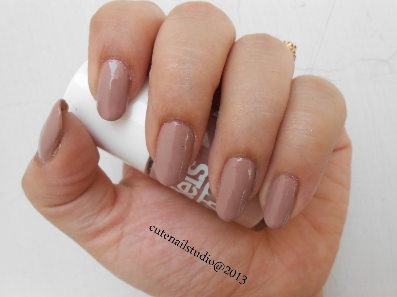 Cute nails: Models own N*de Beige swatch and Jordana Bronze fest