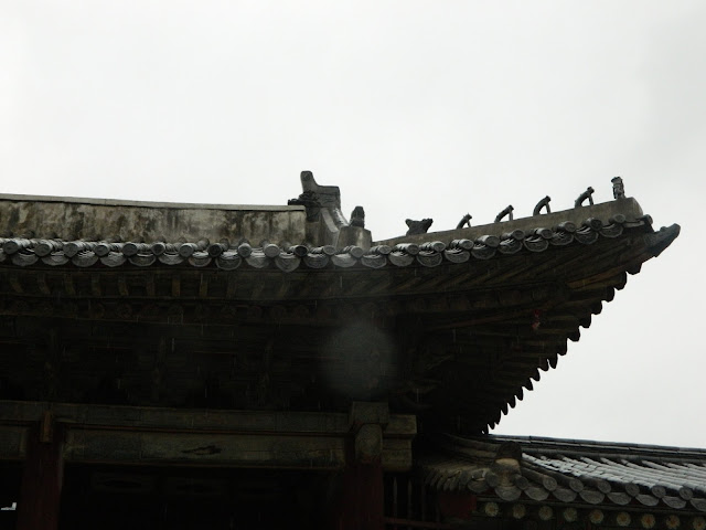 Beautiful roof structure and animals atop.