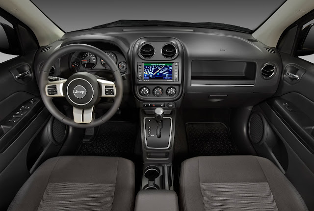 2012 Jeep Compass Latitude interior, in black, with nav system