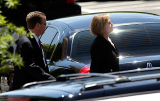 Hillary Clinton leaves the White House after lunching with President Obama on July 29.