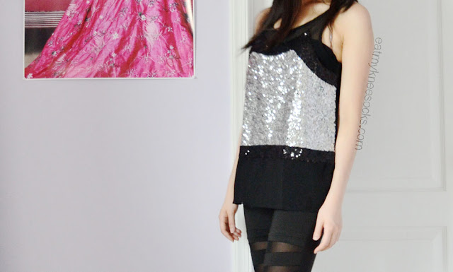 For an effortless party style, pair a festive sequined top with simple, edgy leggings.