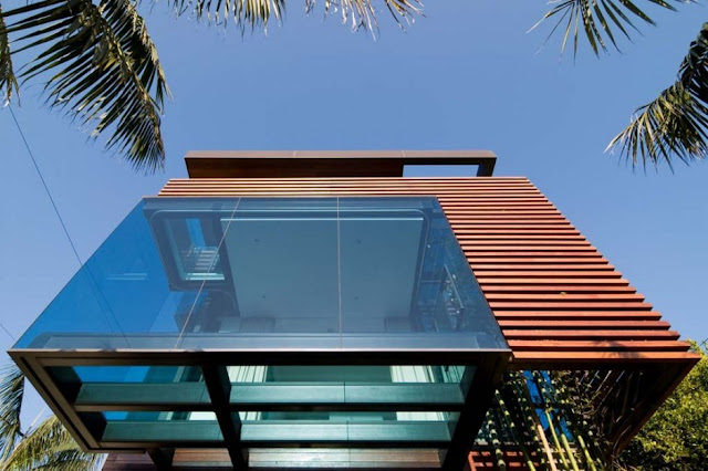 Glass facade with glass floor inside