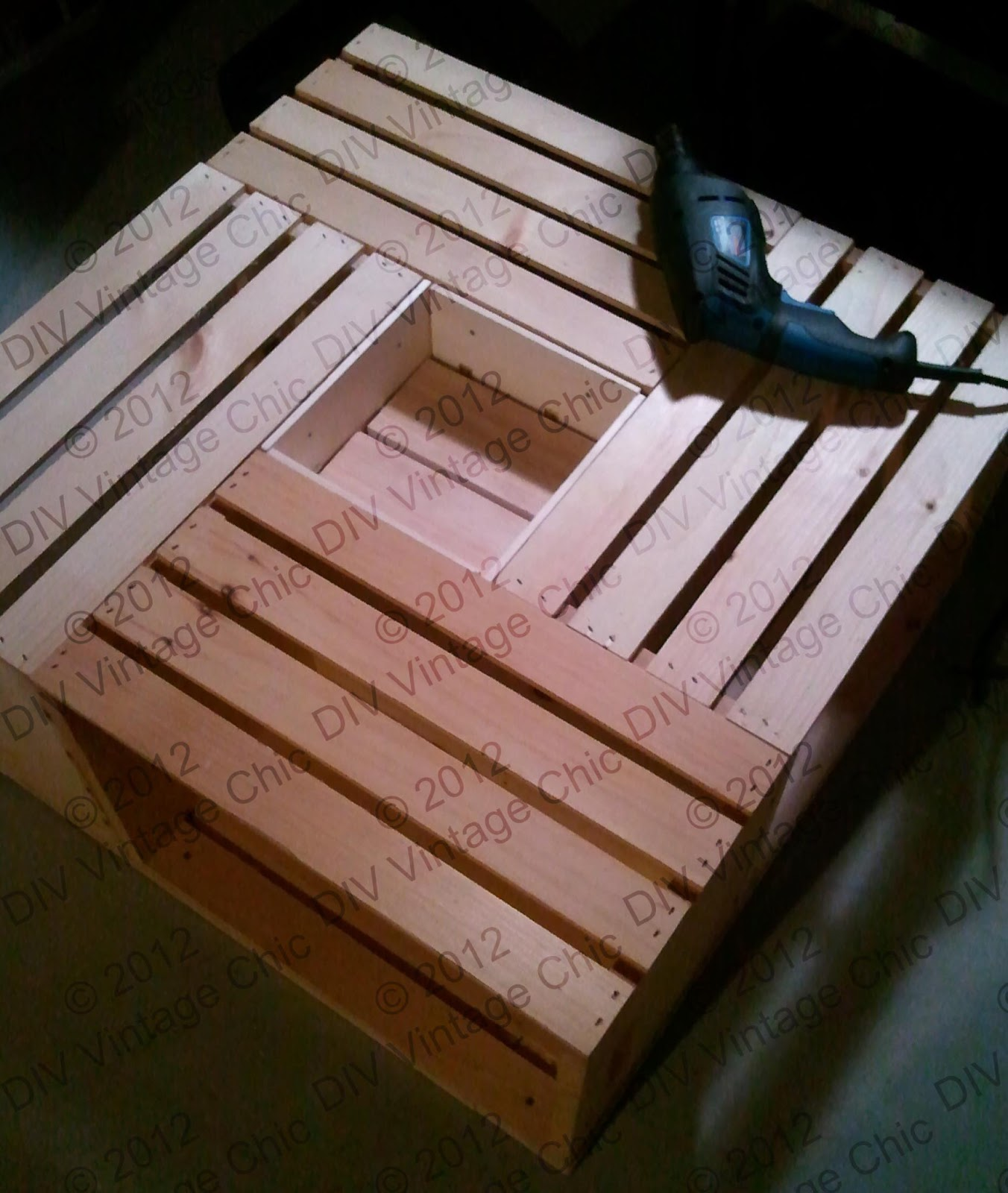 Diy vintage chic vintage wine crate coffee table for How to make a coffee table out of crates