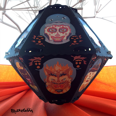 Vintage-style paper lantern by Bindlegrim features six creepy characters for Hallowen - clown, devil, witch, cat, pumpkin, & scarecrow.