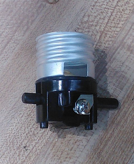 the new bulb socket that would be used to fix my beloved table lamp. Black Bedroom Furniture Sets. Home Design Ideas