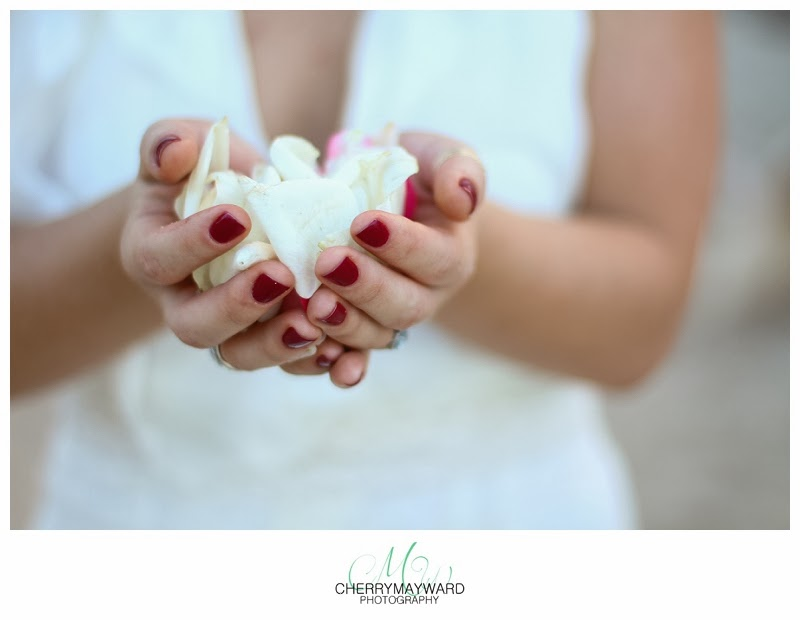bride holding white petals, red wedding nail polish, white rose petals, Koh Samui wedding