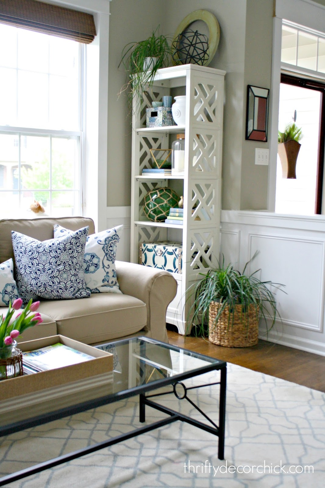Tall white bookcaseLiving Room Redo  from Thrifty Decor Chick. Redo Living Room. Home Design Ideas