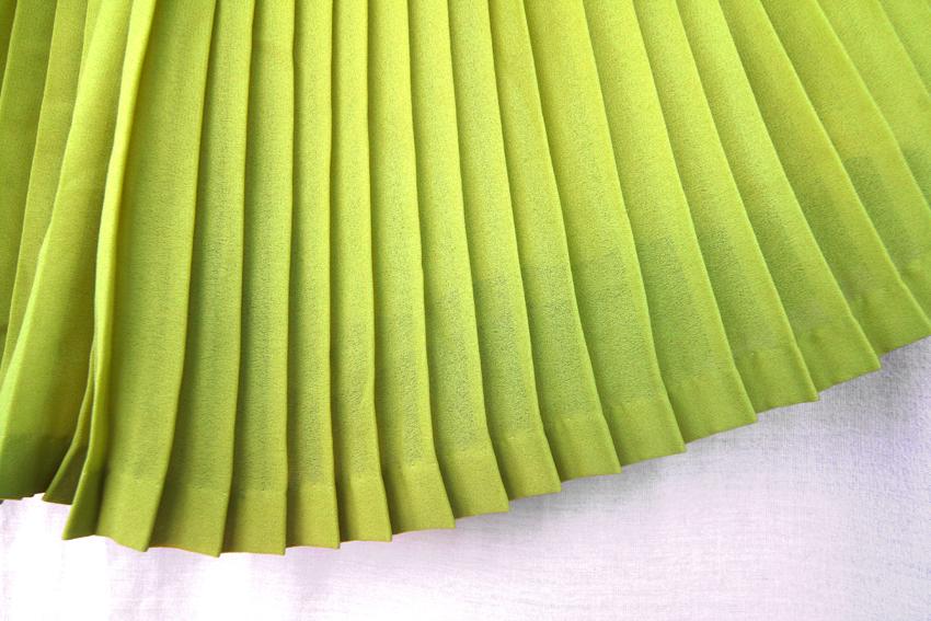fusta pantalon verde crud plisata