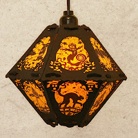 Last of yellow and black limited edition vintage-style lantern The Pumpkin Patch by artist Bindlegrim on sale July 2013
