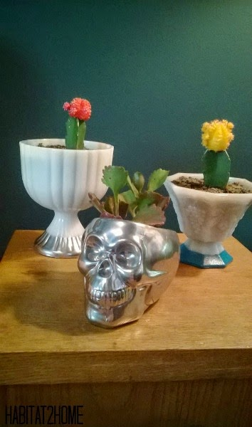 White Glass Pedestal and Mercury Glass Skull Planters