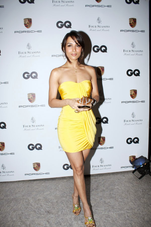 Malaika Arora Khan hot sexy size zero waist hot thunder thighs exposed in yellow mini skirt hd photos