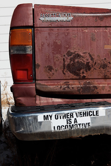 "A bumper sticker in Cheyenne that says, ""My Other Car Is A Locomotive."