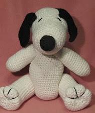 http://www.ravelry.com/patterns/library/crocheted-snoopy-lookalike-amigurumi