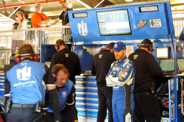 Dale Jr. Observes As His Crew Preps His Car For Practice