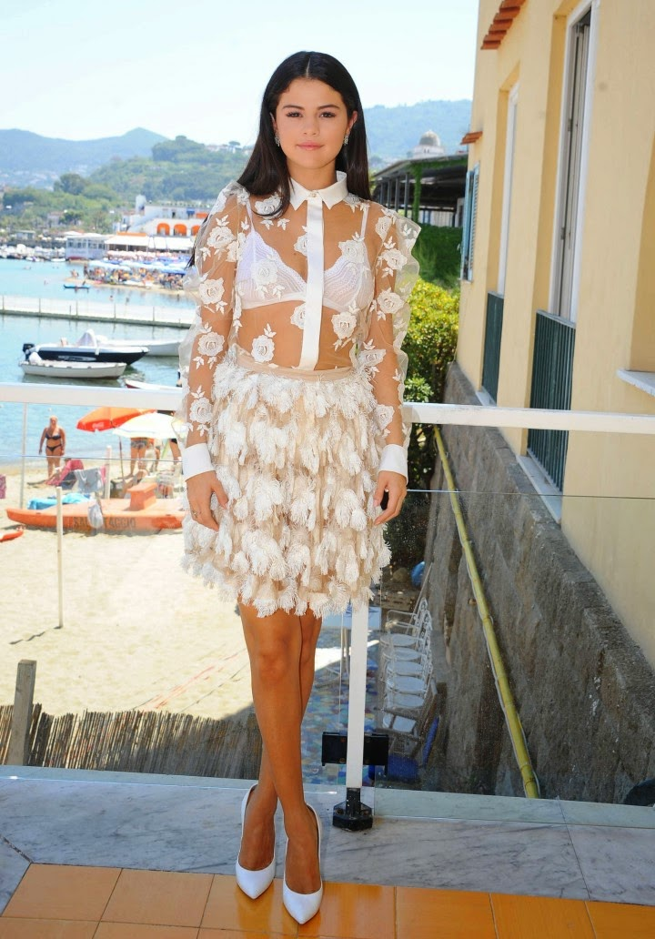 Selena Gomez flashes white bra in a sheer dress at a press conference in Ischia, Italy