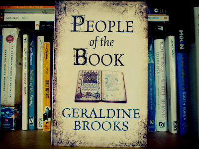 Sarajevo Haggadah, People of the Book, book cover, Geraldine Brooks, library, bookshelf, photograph, review, spines, pages, hardback, paperback
