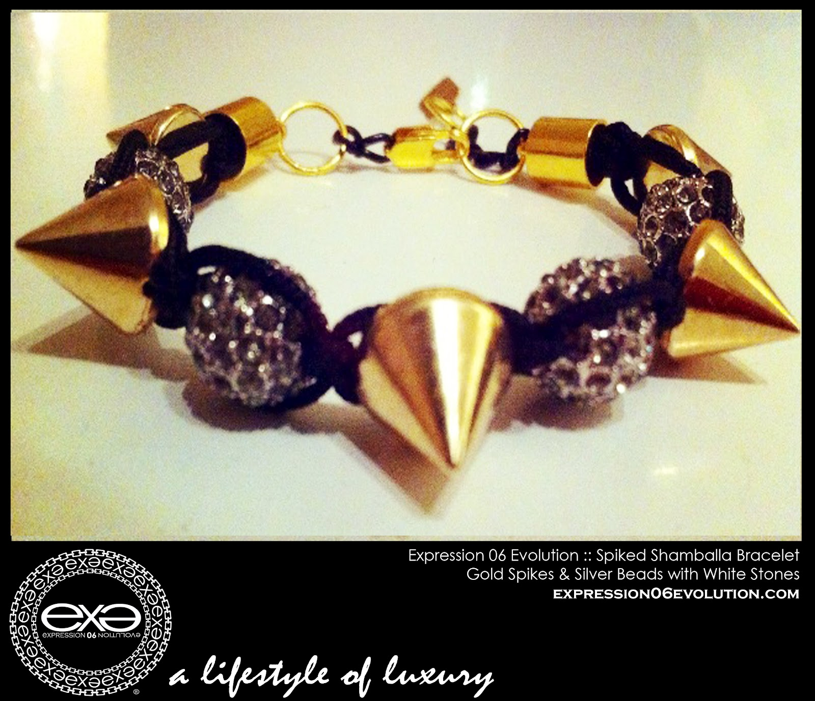http://3.bp.blogspot.com/-q-3pYg5ytBg/UCY4Fqi__PI/AAAAAAAAB2k/IV-1ftVBsTQ/s1600/EXPRESSION+06+EVOLUTION+-+SPIKED+SHAMBALLA+BRACLET+-+GOLD+SPIKES+WITH+WHITE+STONES+-+EXPRESSIVE+CLOTHING+LLC+-+DUSHON+EX+DANIELS+-+ALEXIS+BELSKI+.jpg