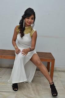 Actress Ishita Latest Stills in White Long Dress at Ippatlo Ramudila Seethala Evaruntaarandi Babu movie Audio Launch  028.jpg