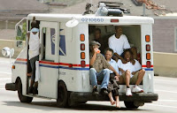 photo image of hurricane Katrina survivors ridding a post office truck