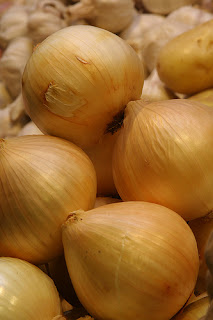 Onions are the least likely to be contaminated with pesticides.
