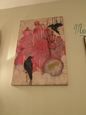 Maryia Grigor's painting of a heart and ravens at The Alterative Cafe in Seaside