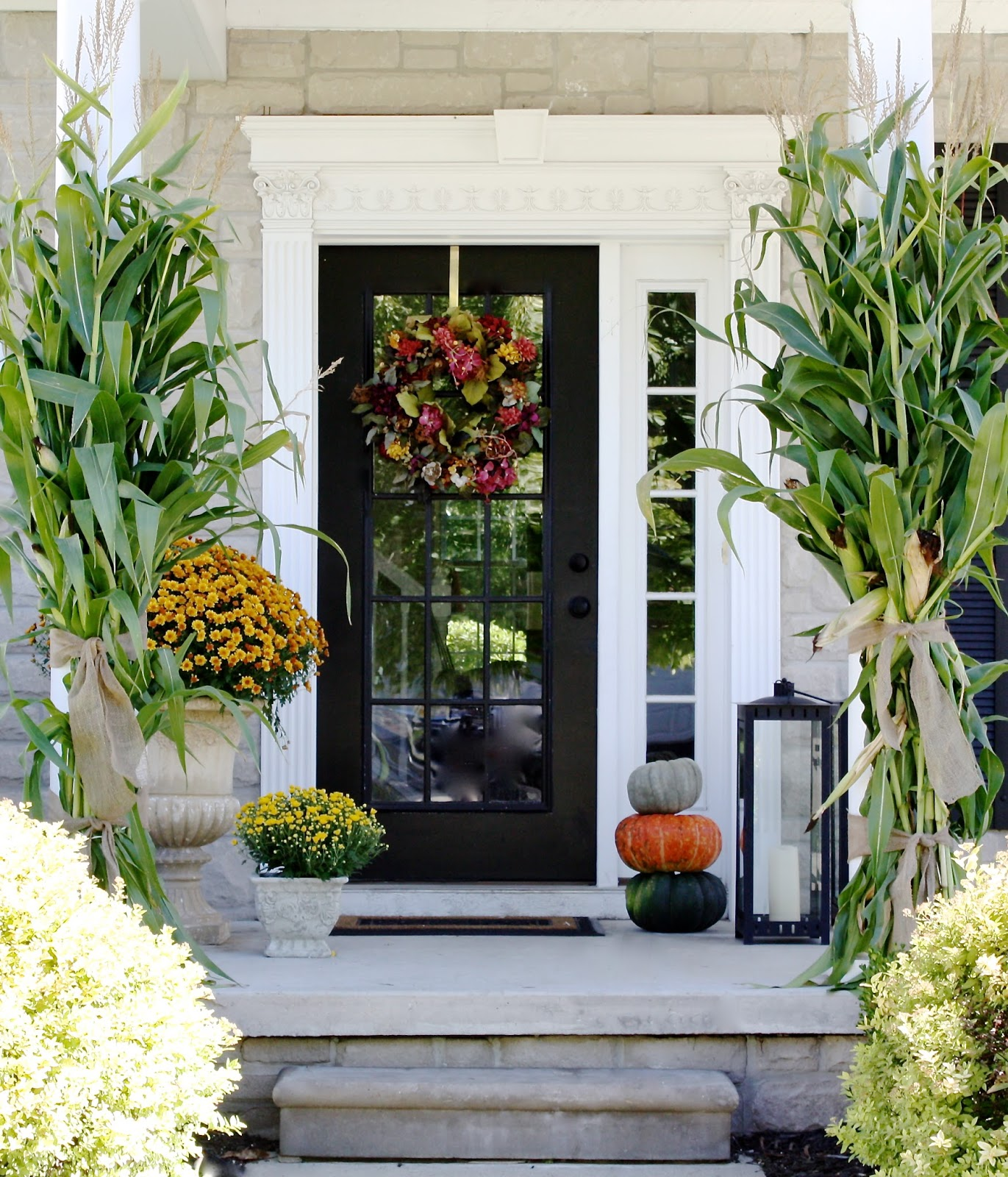 The yellow cape cod fall decorating and a winner of the for Outside foyer designs