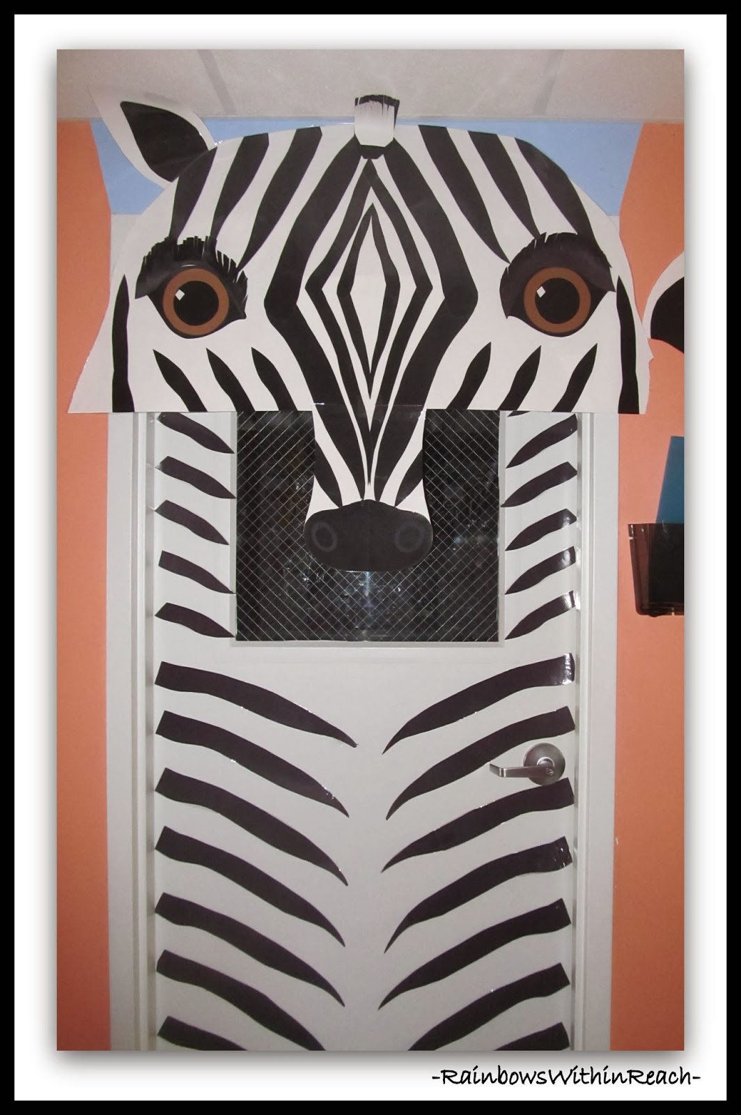 Decorated Classroom Door with Zebra Theme via RainbowsWithinReach