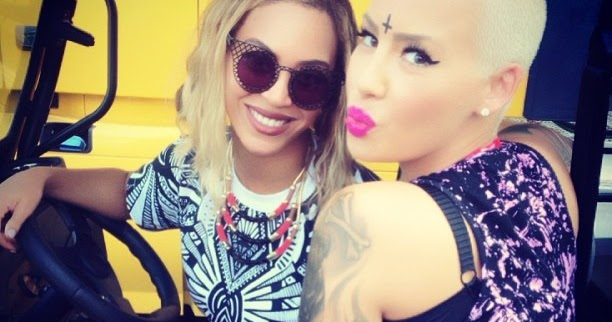 Amber rose to beyonce bash and blue ivy are going to get for Cross tattoo on forehead meaning