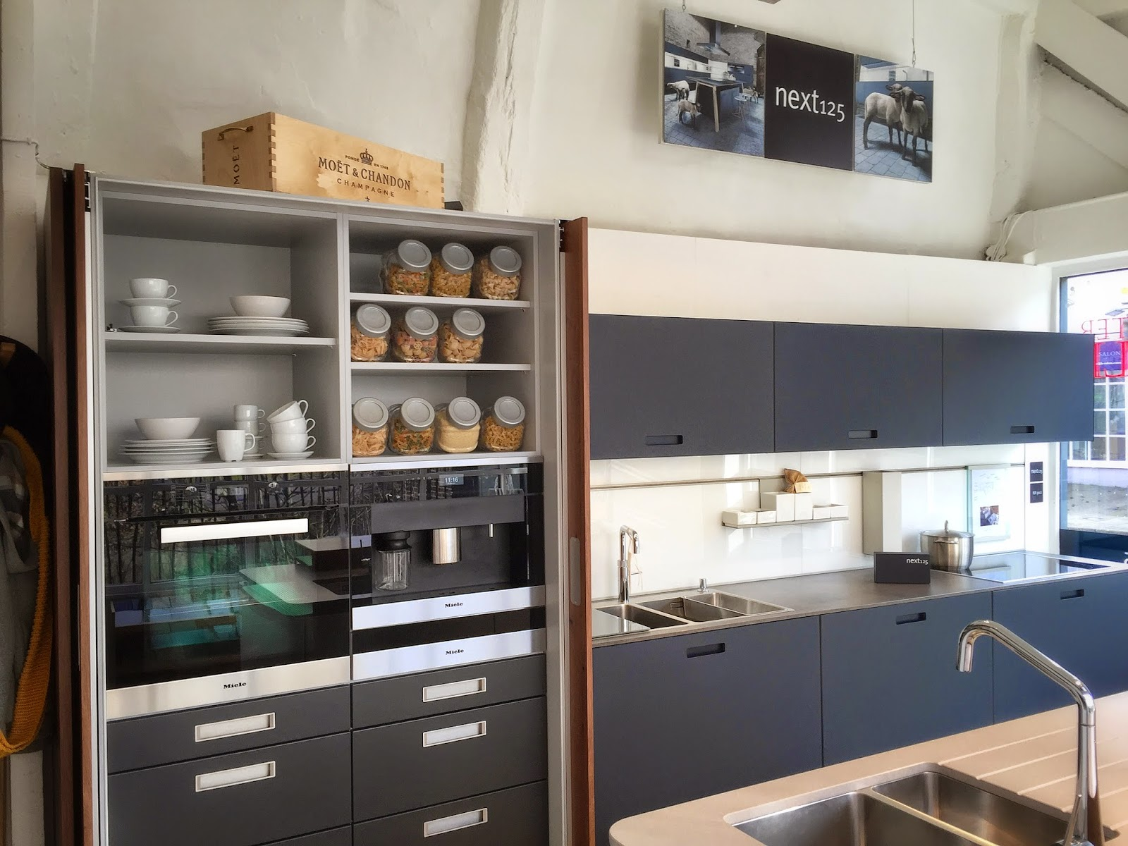 Our Beautiful Next125 Navy And Walnut Display With Miele Appliances.
