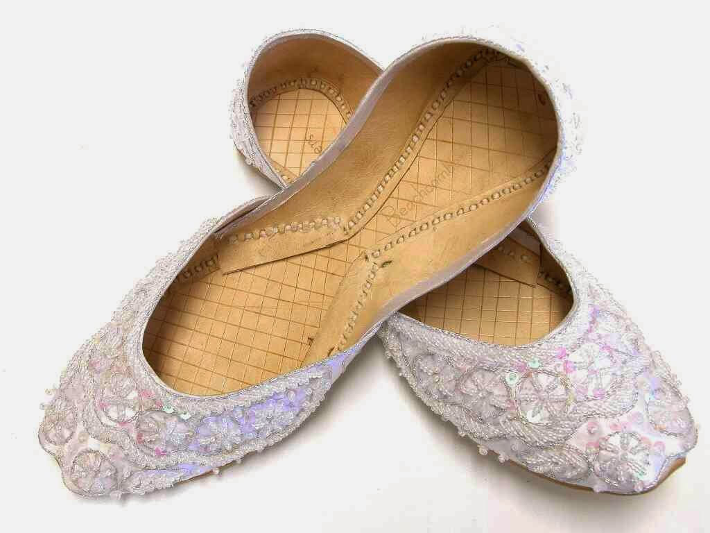 White silk covered beaded flats that are perfect for bridal shoes.