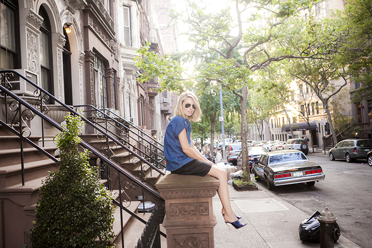 Upper West Side brownstone tree-lined street at golden hour, New York City, black & navy outfit, Nina Ricci satin mules
