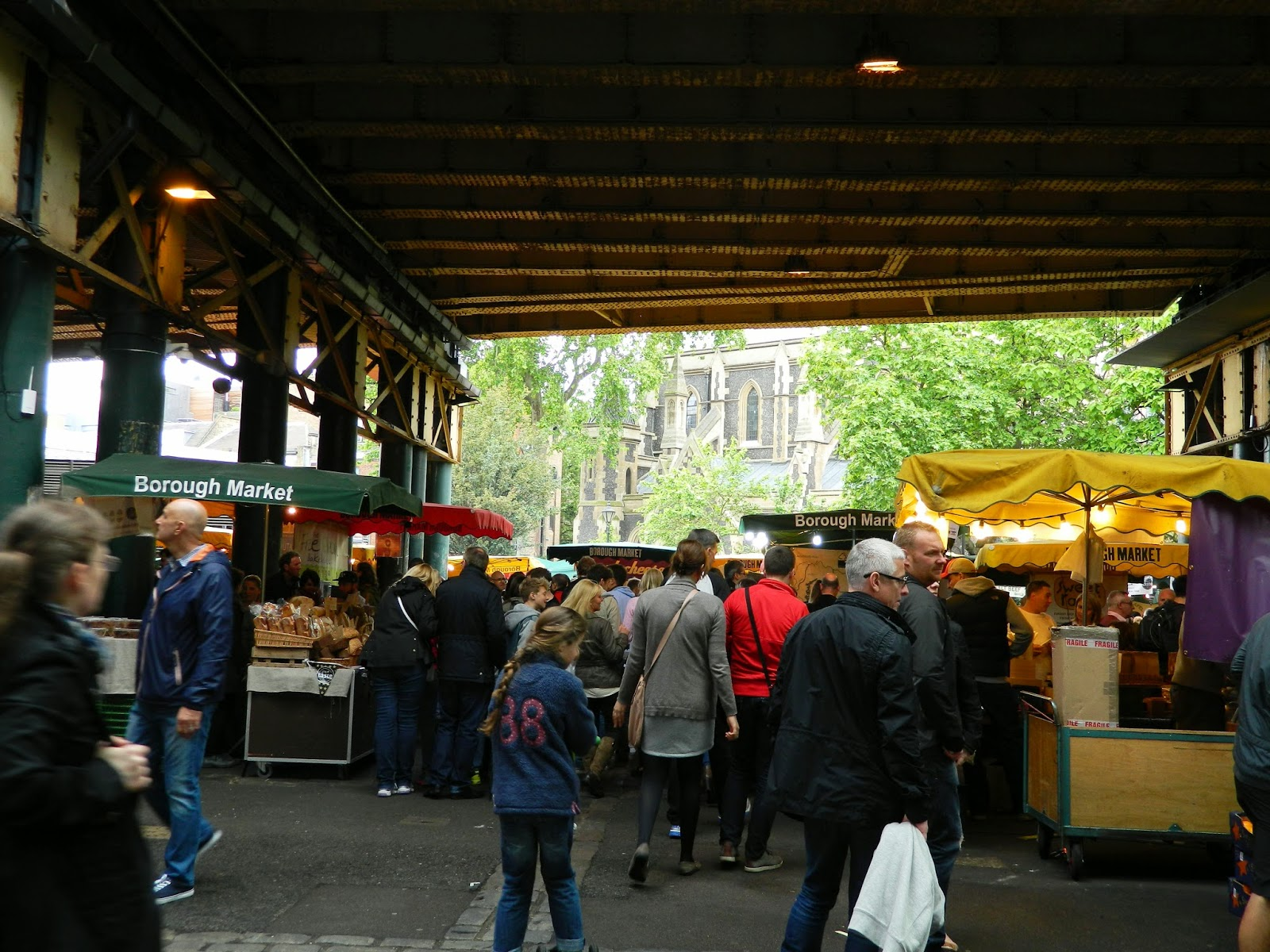 borough market london train bridge next to a cathedral