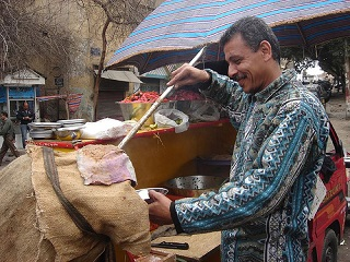 Serving local street food photo by dlisbona