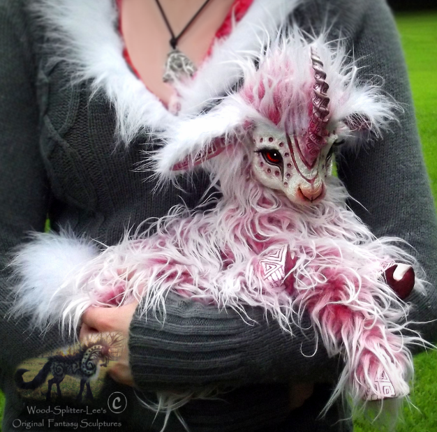 Image of a long-haired pink fantasy type baby goat creature