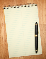 pad and pen ready to write down goals