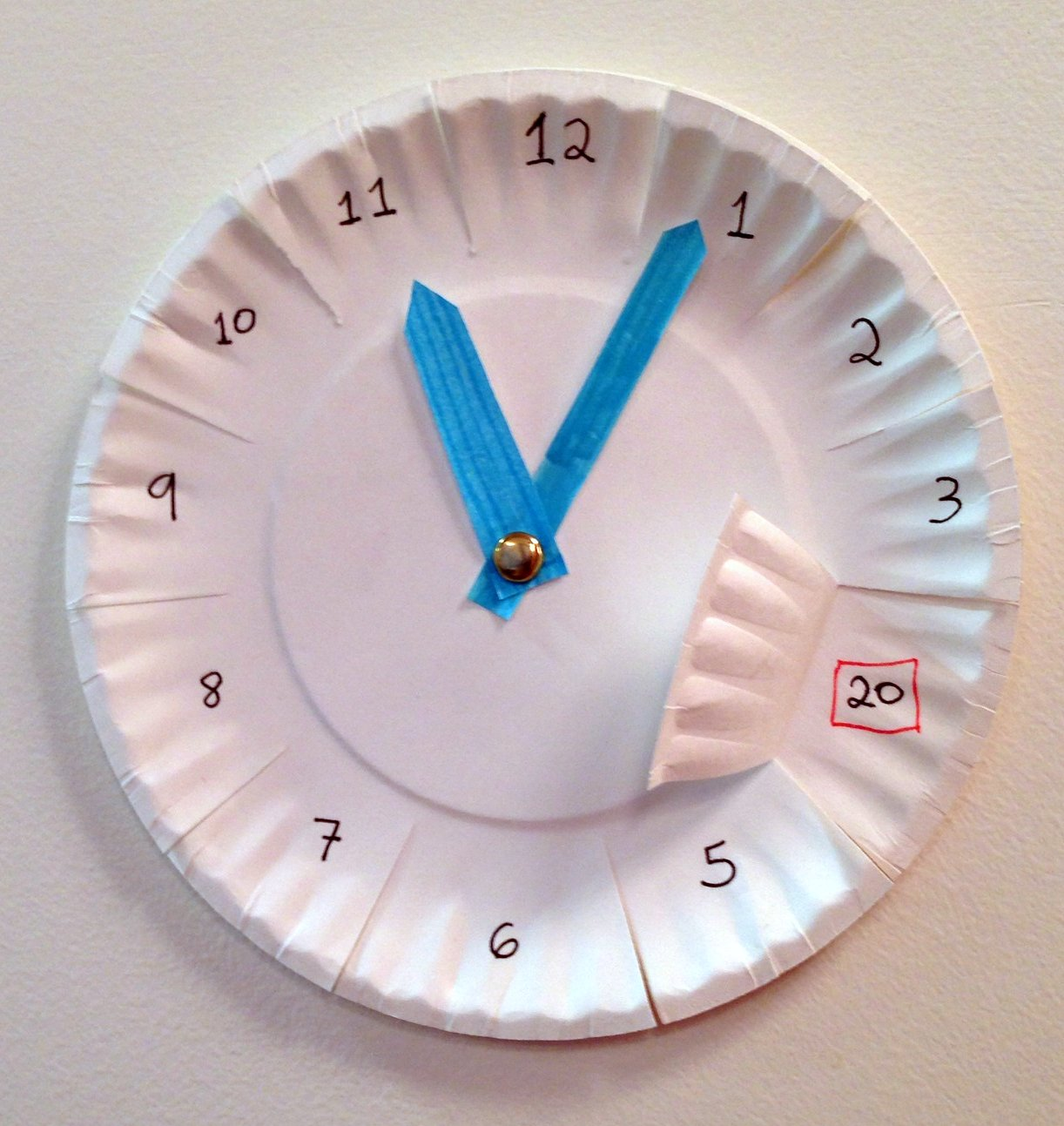 Watch How to Make a Paper Clock video
