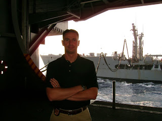 NCIS Special Agent Chad Willie pictured aboard the USS Harry S. Truman Aircraft Carrier 90 miles off North Carolina.