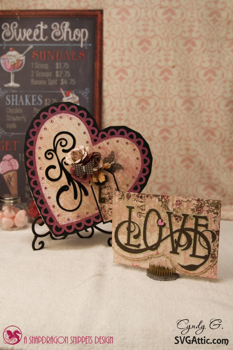 Scene with heart candy box and Love Valentine card
