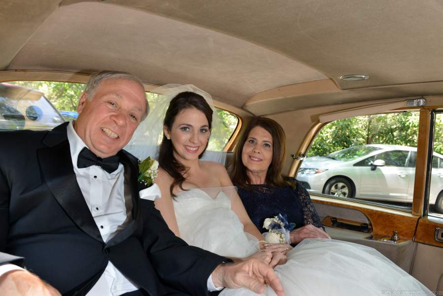 Bride and parents inside the Rolls Royce