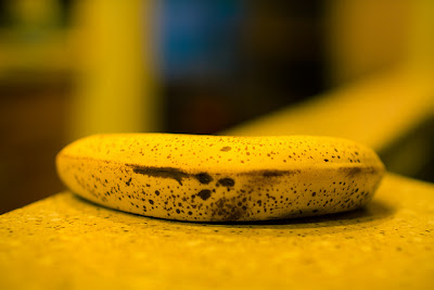 Brown banana on table