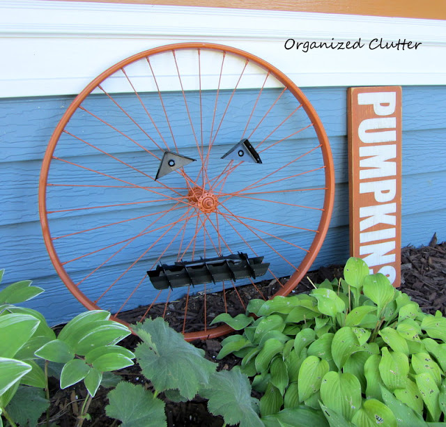 Up-Cycled Bicycle Wheel Garden Pumpkin